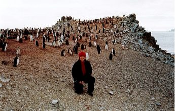 Sandi Davison, PA/Administrator, with Chinstrap Penguins on Half Moon Island, Antarctica